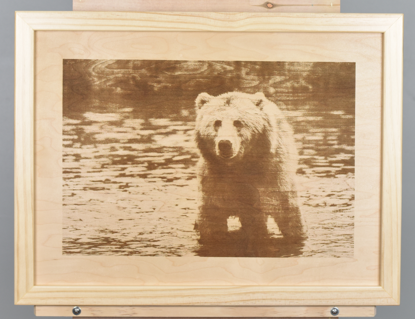 A wood burning (digital pyrograph) of brown bear in a river based on a photograph by Skeeze.