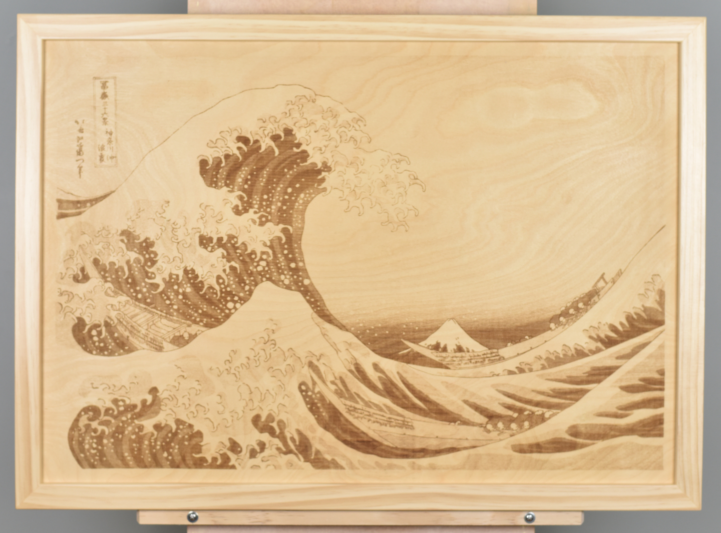 A wood burning (digital pyrograph) showing a huge wave bearing down on boats with a view of Mount Fuji in the background. One of the famous Thirty-six Views of Mount Fuji by Katsushika Hokusai.