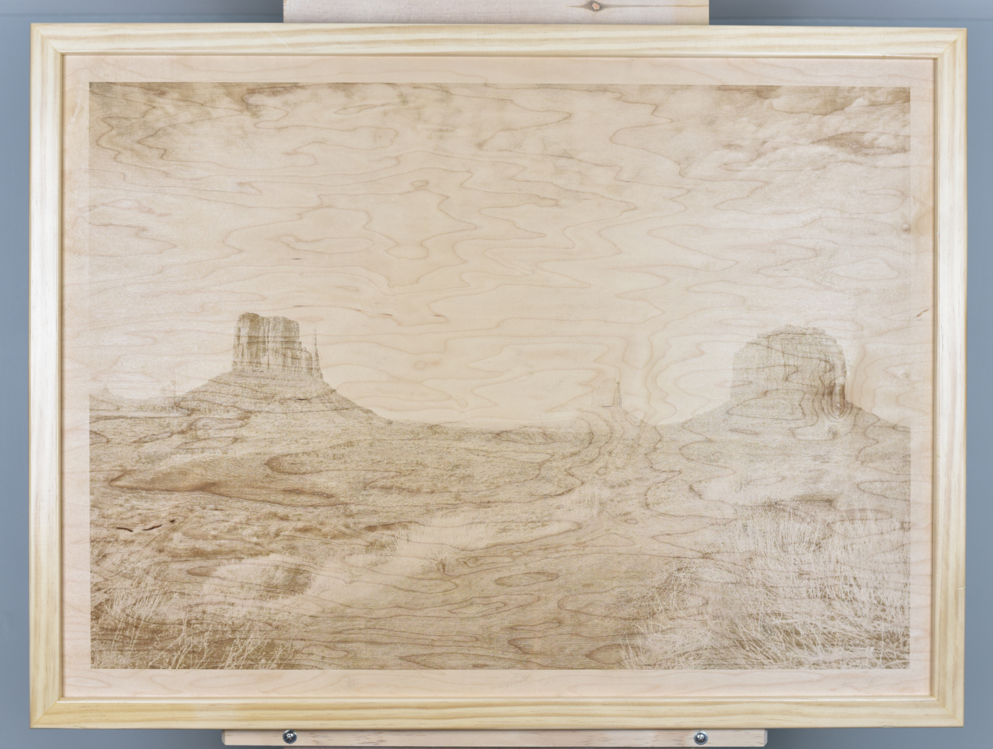 A wood burning (digital pyrograph) of red sandstone mesas (buttes) towering over Monument Valley Arizona. Photograph by Carol Highsmith.