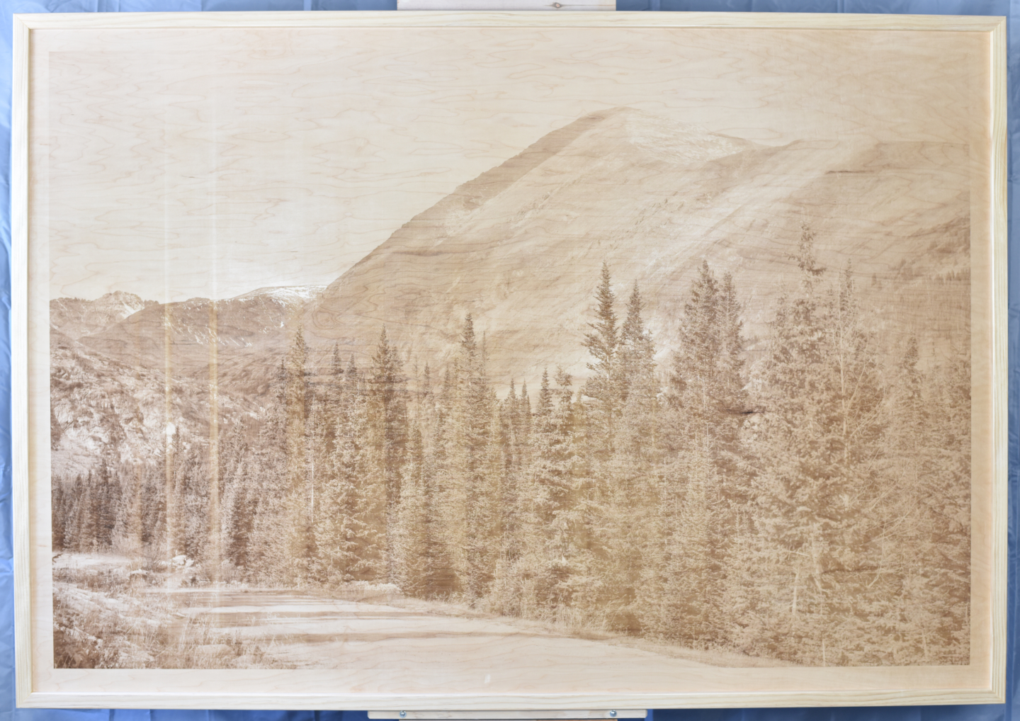 A wood burning (digital pyrograph) of the South side of Quandary Peak in Colorado on a windy, cloudy, and snowy Fall day.